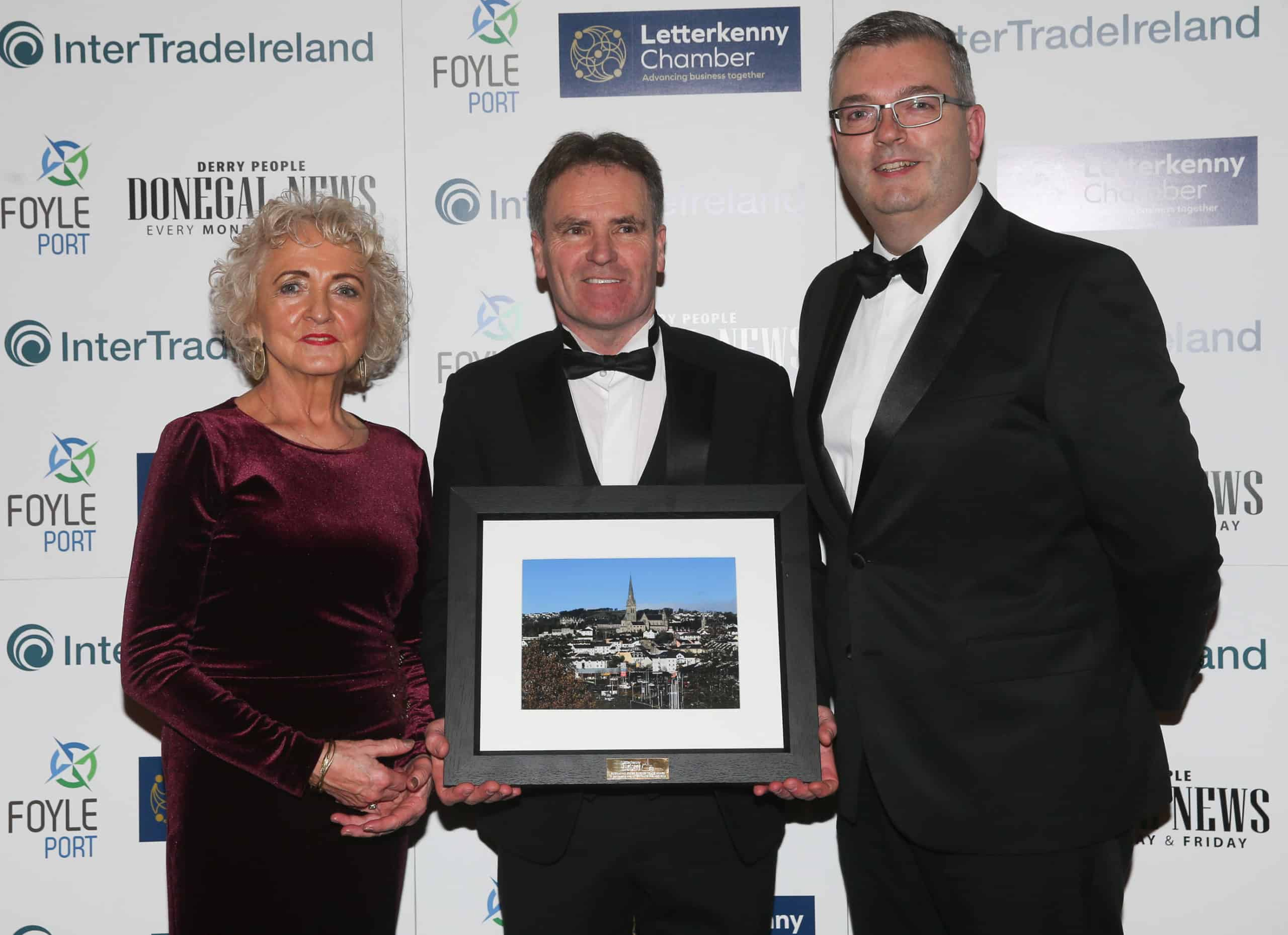 Embracing Cross Border Trade Award winner PJ Patton, PJ Design presented by Claire McNickle LK Chamber and Grant Gilmore, InterTradeIreland.